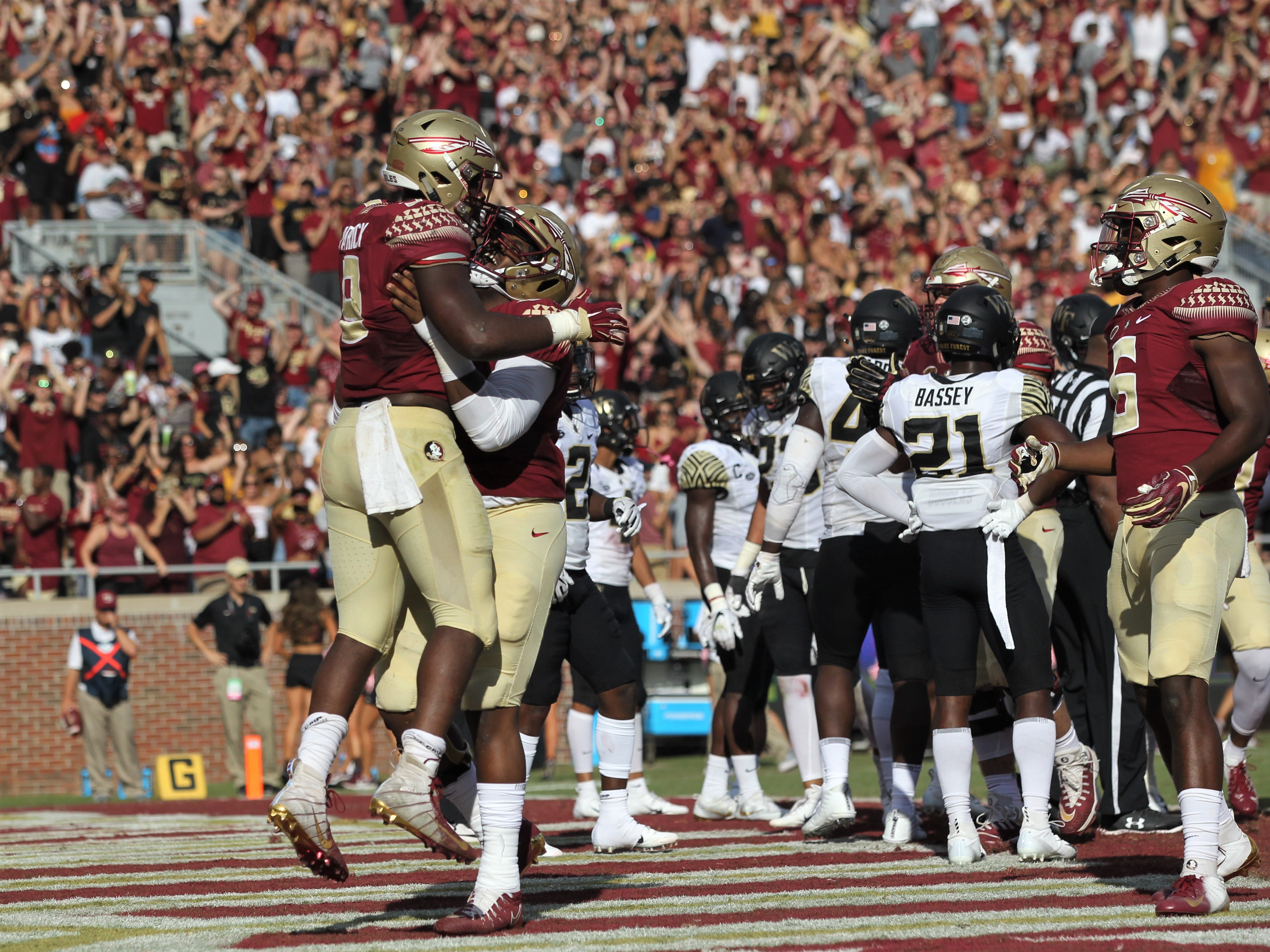 Florida State running back Jacques Patrick is lifted up by offensive lineman Baveon Johnson after a two-yard touchdown run in the second quarter of a game against Wake Forest at Doak Campbell Stadium on Oct. 20, 2018.