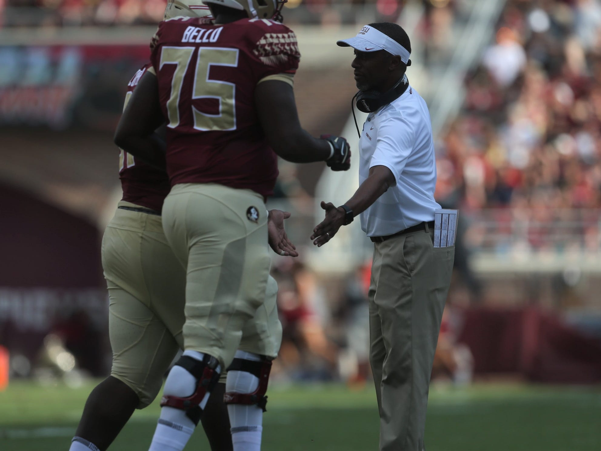 Florida State football head coach Willie Taggart congratulates his team after a touchdown during a game against Wake Forest at Doak Campbell Stadium on Saturday, Oct. 20, 2018.