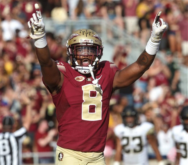 Florida State receiver Nyqwan Murray signals to the crowd after a receiving touchdown against Wake Forest during a game at Doak Campbell Stadium on Saturday, Oct. 20, 2018.