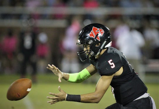 NFC quarterback J.D. Jerry catches a snap during Friday's game against Jefferson County.