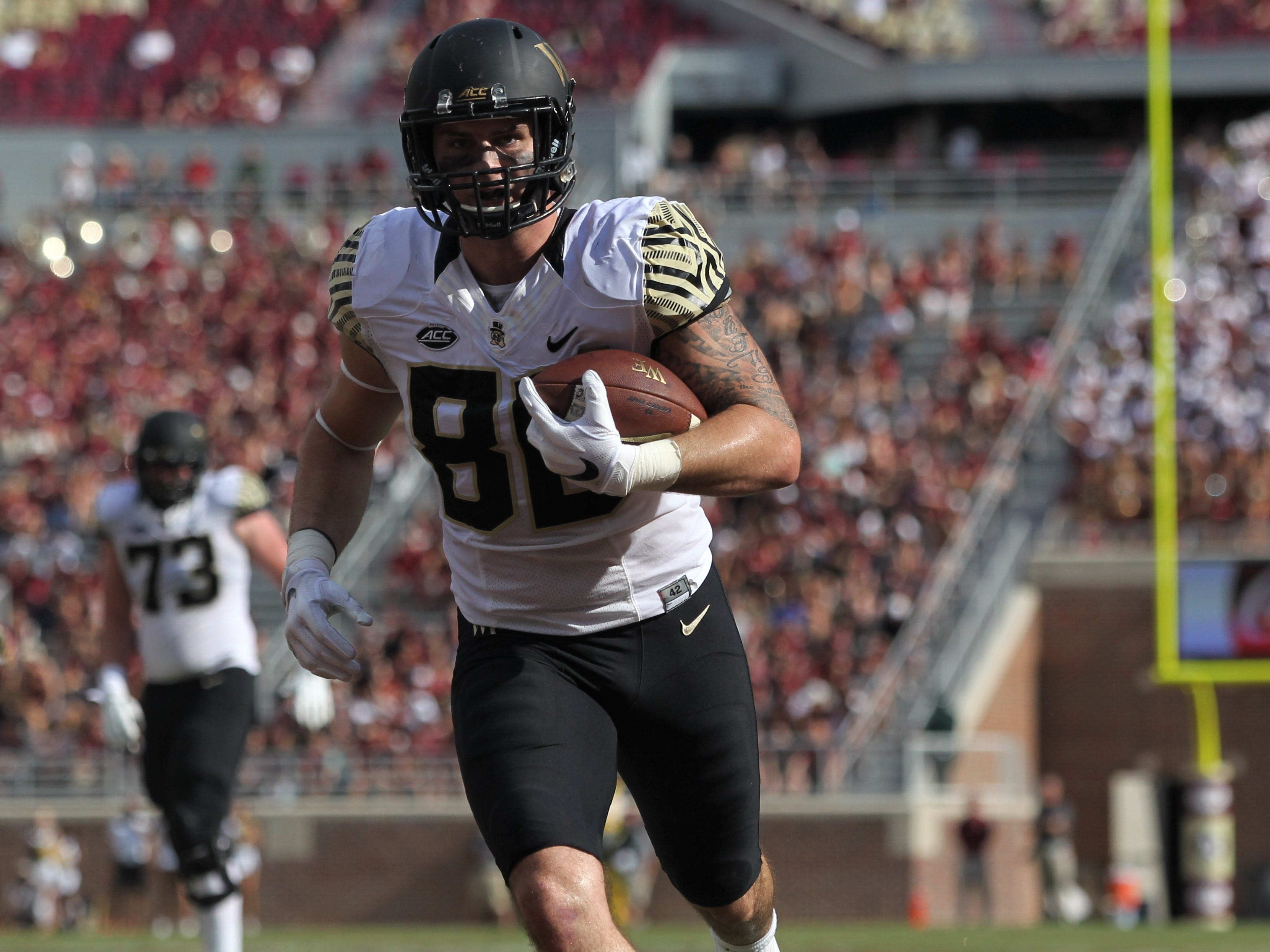 Wake Forest tight end Jack Freudenthal breaks free of Florida State defensive back Hamsah Nasirildeen for a touchdown at Doak Campbell Stadium on Saturday, Oct. 20, 2018.
