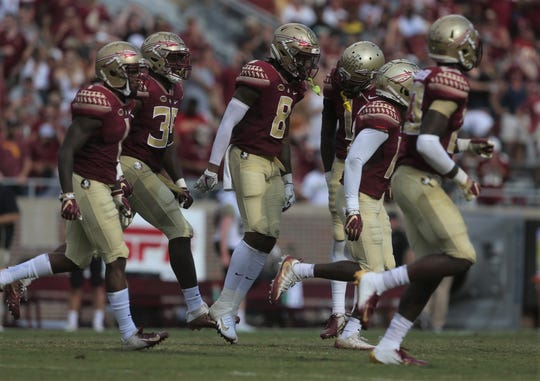 Florida State defensive back Stanford Samuels III (8) celebrates with his defensive teammates after Samuels' interception of Wake Forest during a game at Doak Campbell Stadium on Saturday, Oct. 20, 2018.