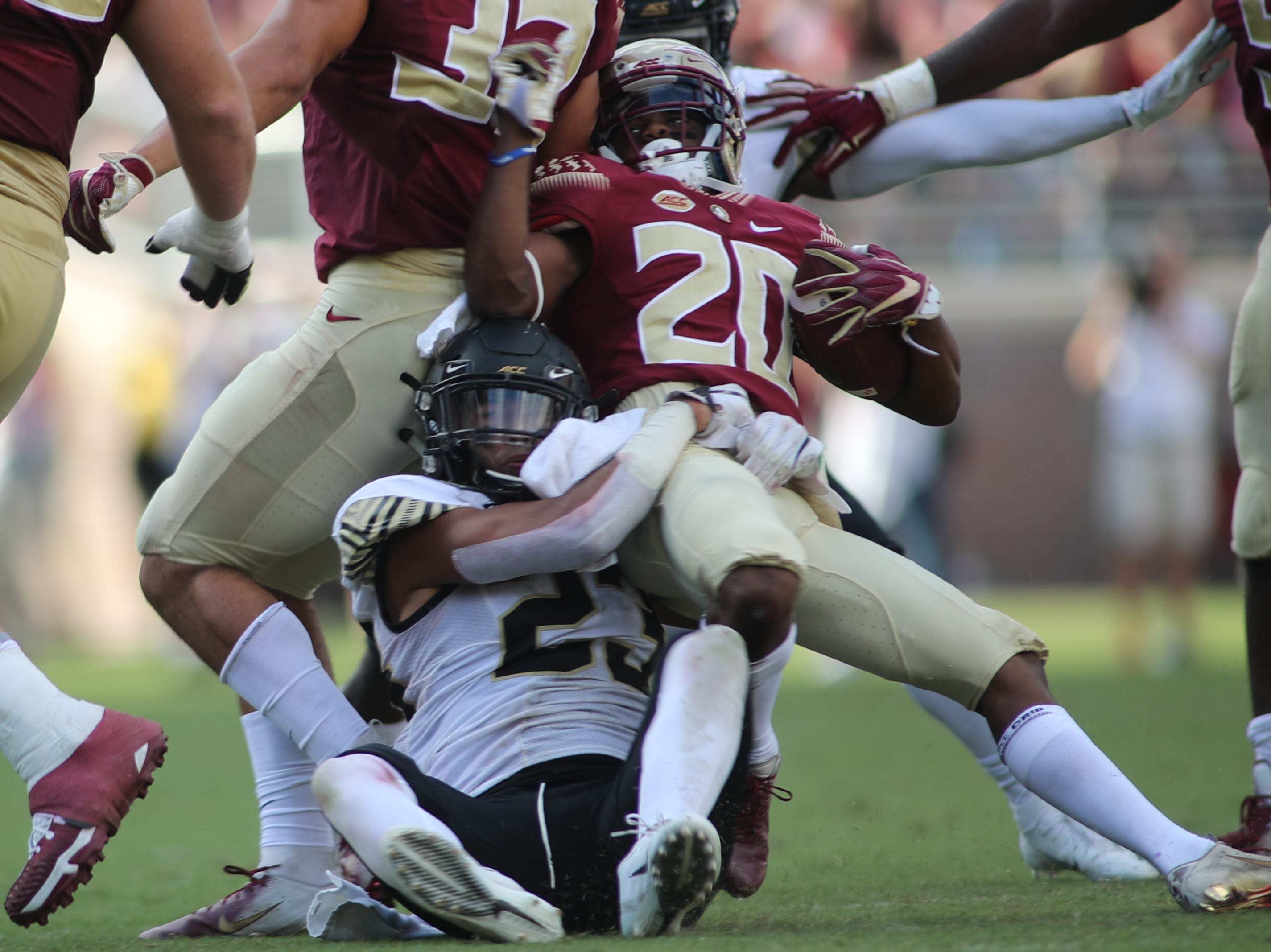 Wake Forest Demon Deacons linebacker Justin Strnad (23) brings down Florida State Seminoles wide receiver Keyshawn Helton (20) during FSU's homecoming game against Wake Forest at Doak S. Campbell Stadium Saturday, Oct. 20, 2018.