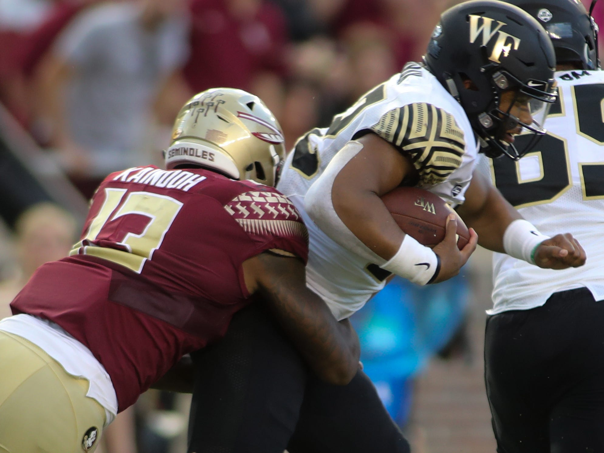Florida State Seminoles defensive end Joshua Kaindoh (13) sacks Wake Forest Demon Deacons quarterback Tayvone Bowers (13) during FSU's homecoming game against Wake Forest at Doak S. Campbell Stadium Saturday, Oct. 20, 2018.