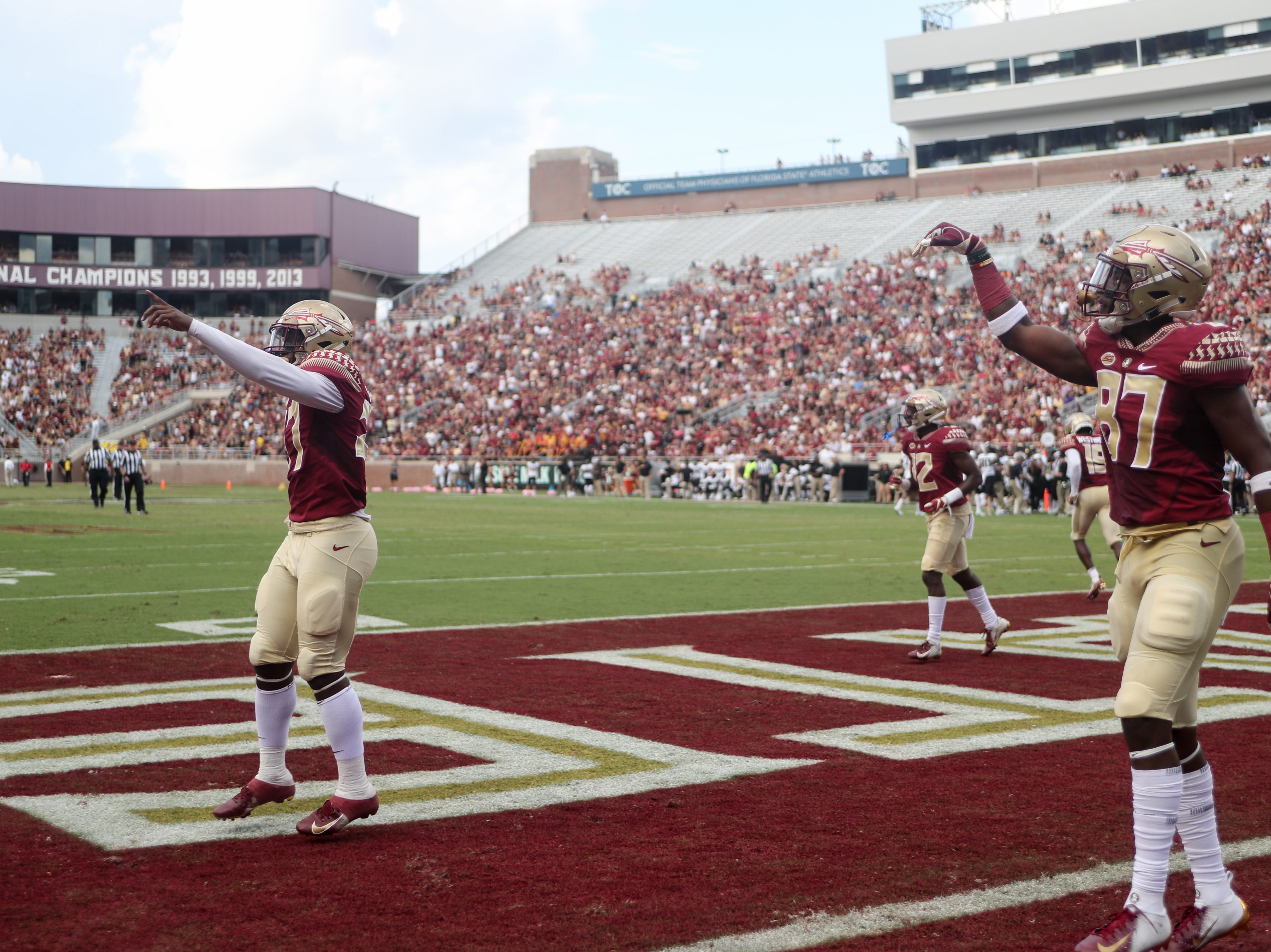 Florida State Seminoles wide receiver Ontaria Wilson (27), quarterback Deondre Francois (12) and tight end Camren McDonald (87) celebrate in the end zone during FSU's homecoming game against Wake Forest at Doak S. Campbell Stadium Saturday, Oct. 20, 2018.