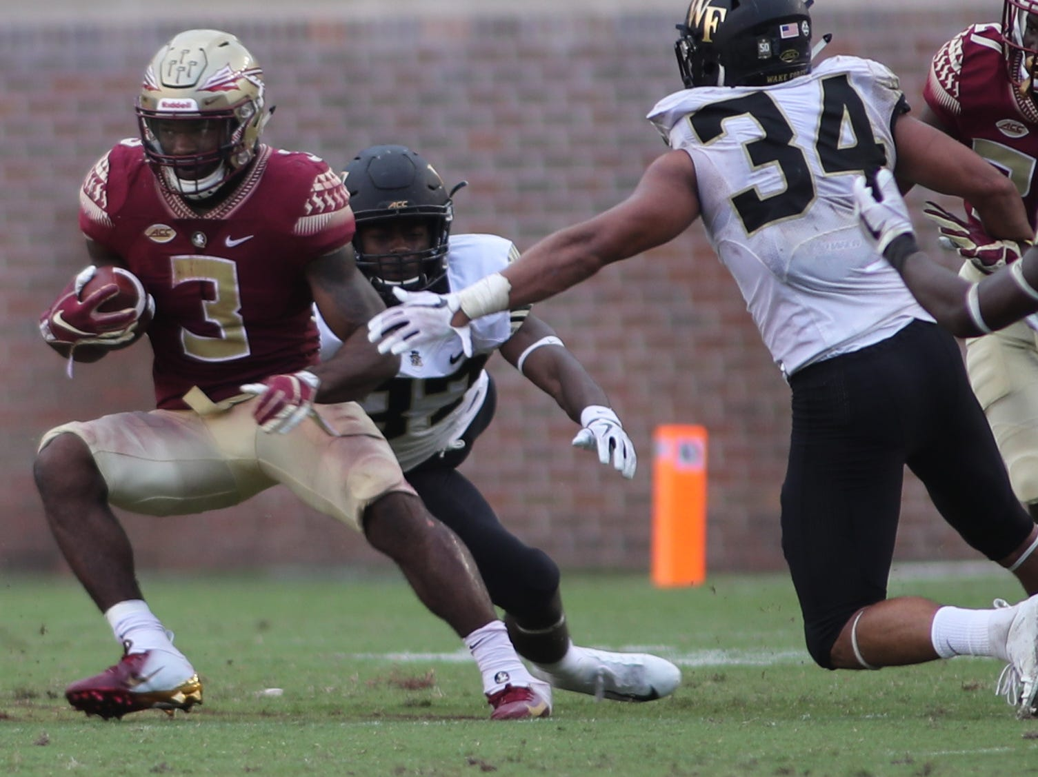 Florida State Seminoles running back Cam Akers (3) dodges defenders during FSU's homecoming game against Wake Forest at Doak S. Campbell Stadium Saturday, Oct. 20, 2018.