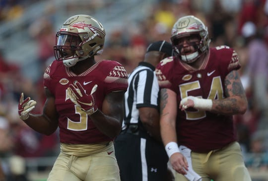 Florida State running back Cam Akers celebrates a touchdown in front of lineman Alec Eberle during a game against Wake Forest at Doak Campbell Stadium on Saturday, Oct. 20, 2018.