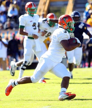 FAMU wide receiver Azende Rey makes a run after the catch versus N.C. A&T.