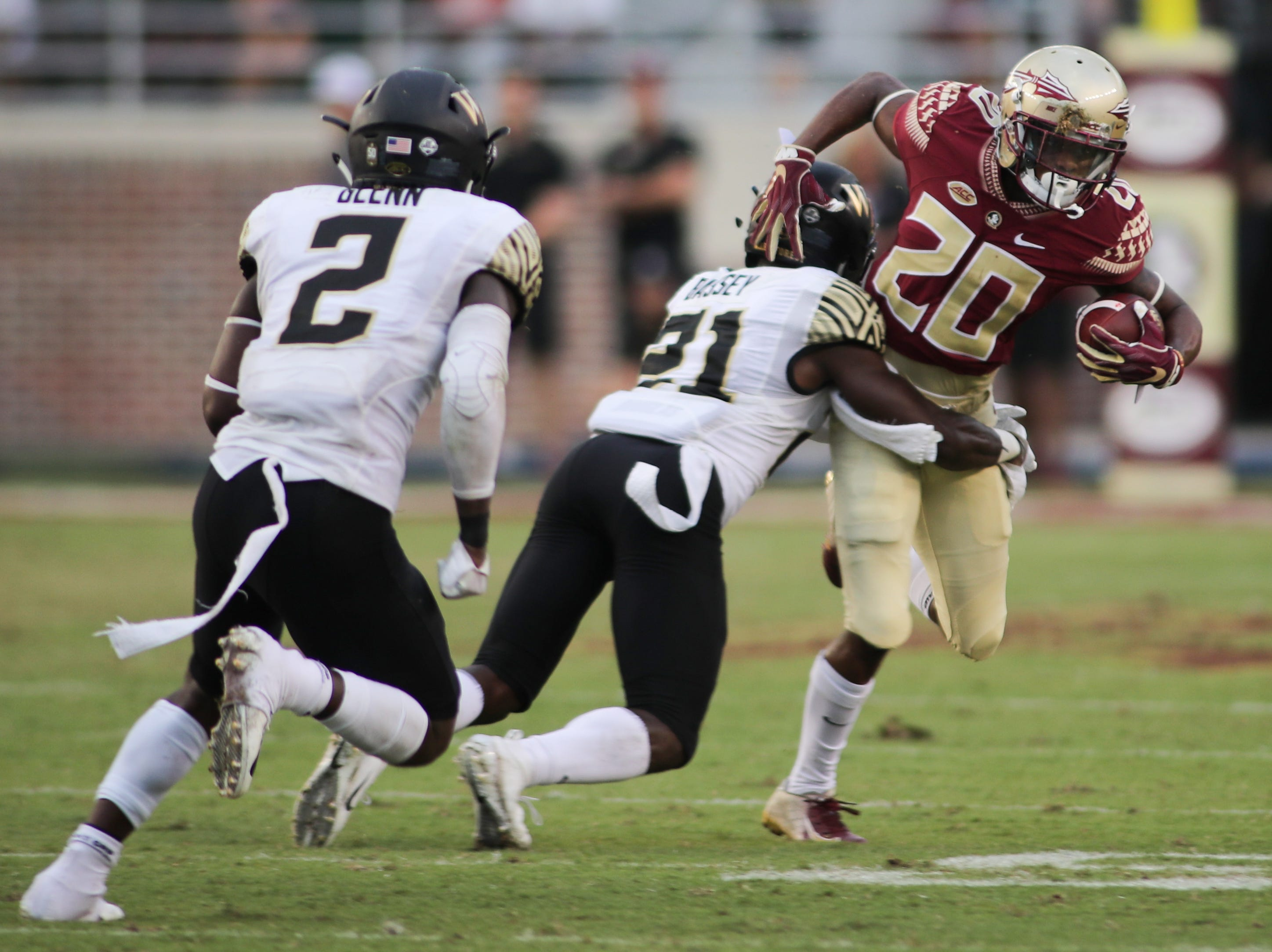 Florida State Seminoles wide receiver Keyshawn Helton (20) is tackled by Wake Forest Demon Deacons defensive back Essang Bassey (21) during FSU's homecoming game against Wake Forest at Doak S. Campbell Stadium Saturday, Oct. 20, 2018.