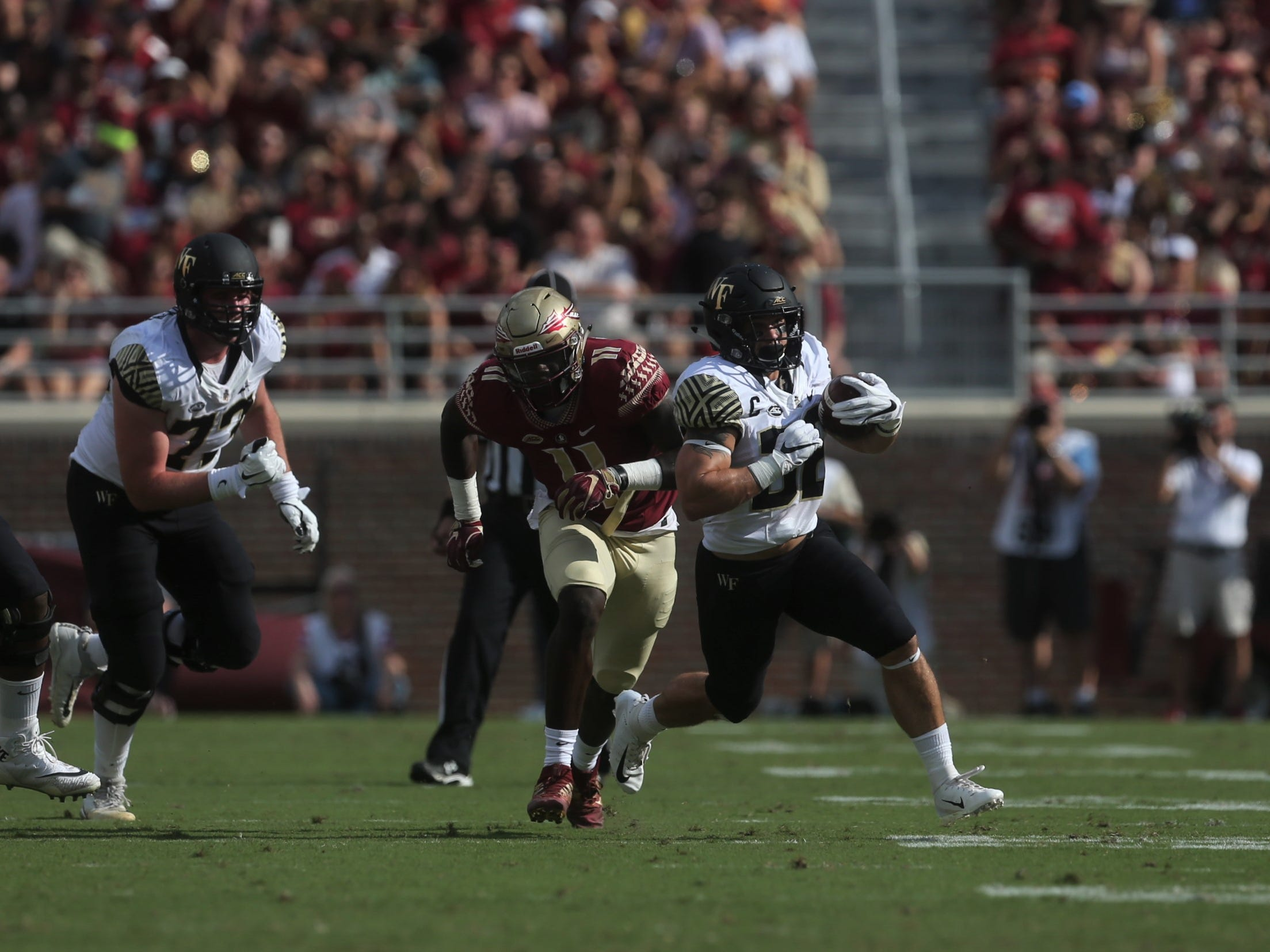 Wake Forest running back Cade Carney tries gets past Florida State defensive ned Janarius Robinson during a game at Doak Campbell Stadium on Saturday, Oct. 20, 2018.