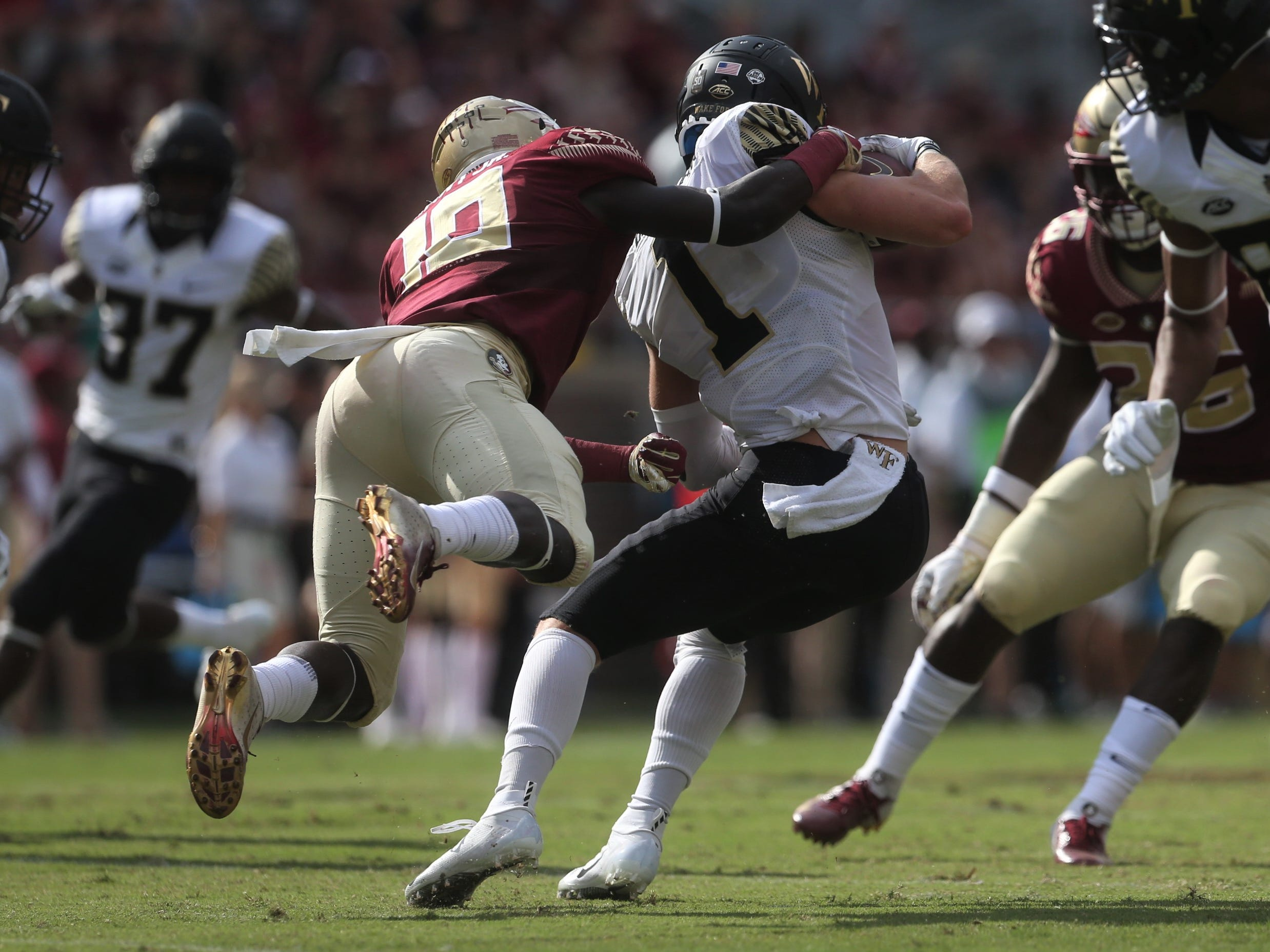 Florida State's Anthony Grant tries to bring down Wake Forest's Alex Bachman on a punt return during a game at Doak Campbell Stadium on Saturday, Oct. 20, 2018.