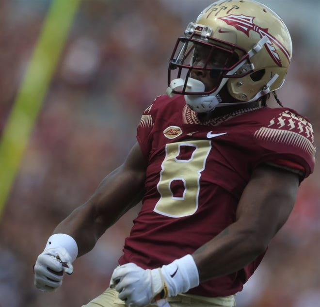 Florida State receiver Nyqwan Murray flexes his muscles after making a catch against Wake Forest during a game at Doak Campbell Stadium on Saturday, Oct. 20, 2018.