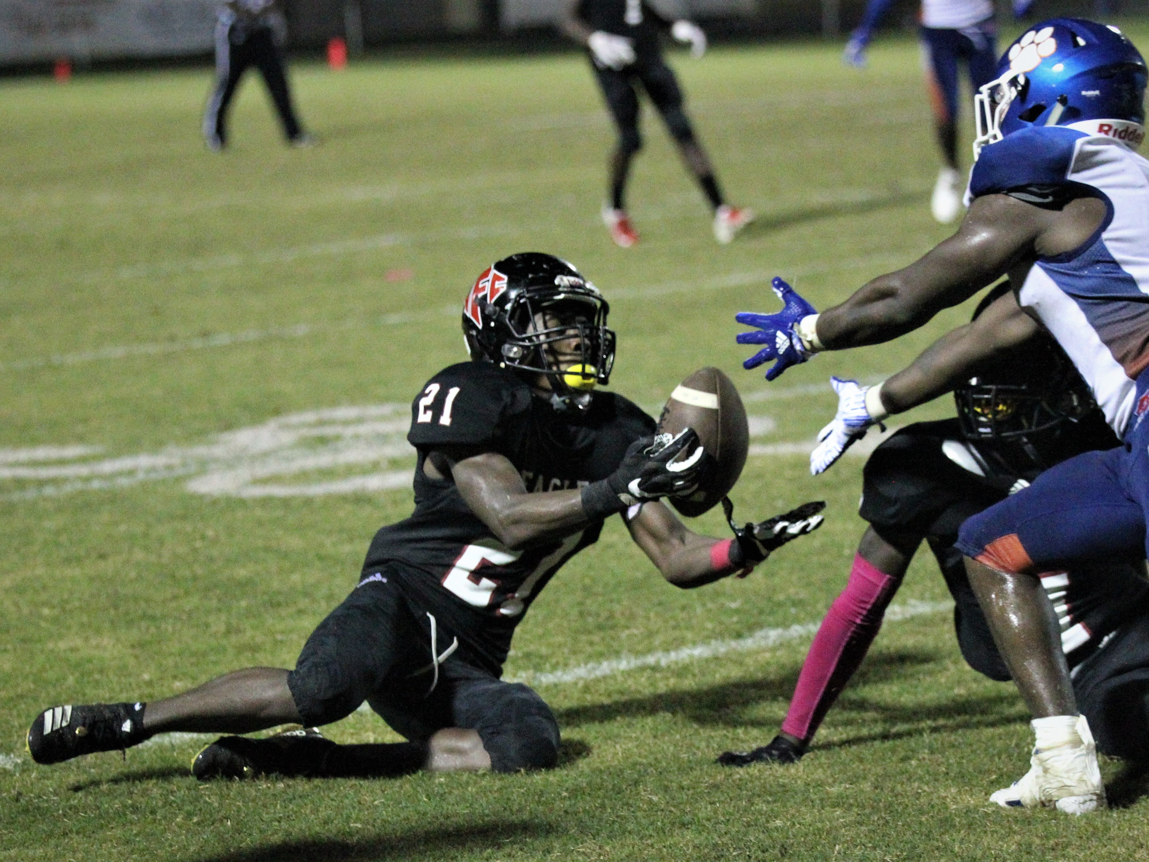 NFC defensive back Von Hayes comes up with an interception off a tipped ball during the Eagles' win over Jefferson County on Friday night.
