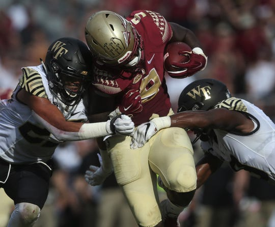 Florida State running back Jacques Patrick takes on Wake Forest defenders near the goal line during a game at Doak Campbell Stadium on Saturday, Oct. 20, 2018.