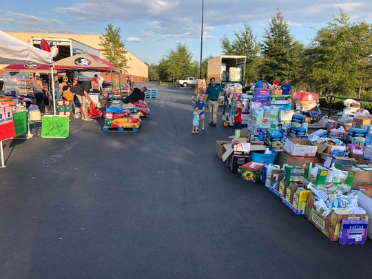 Volunteers load supplies at the United Partners for Human Services drive.