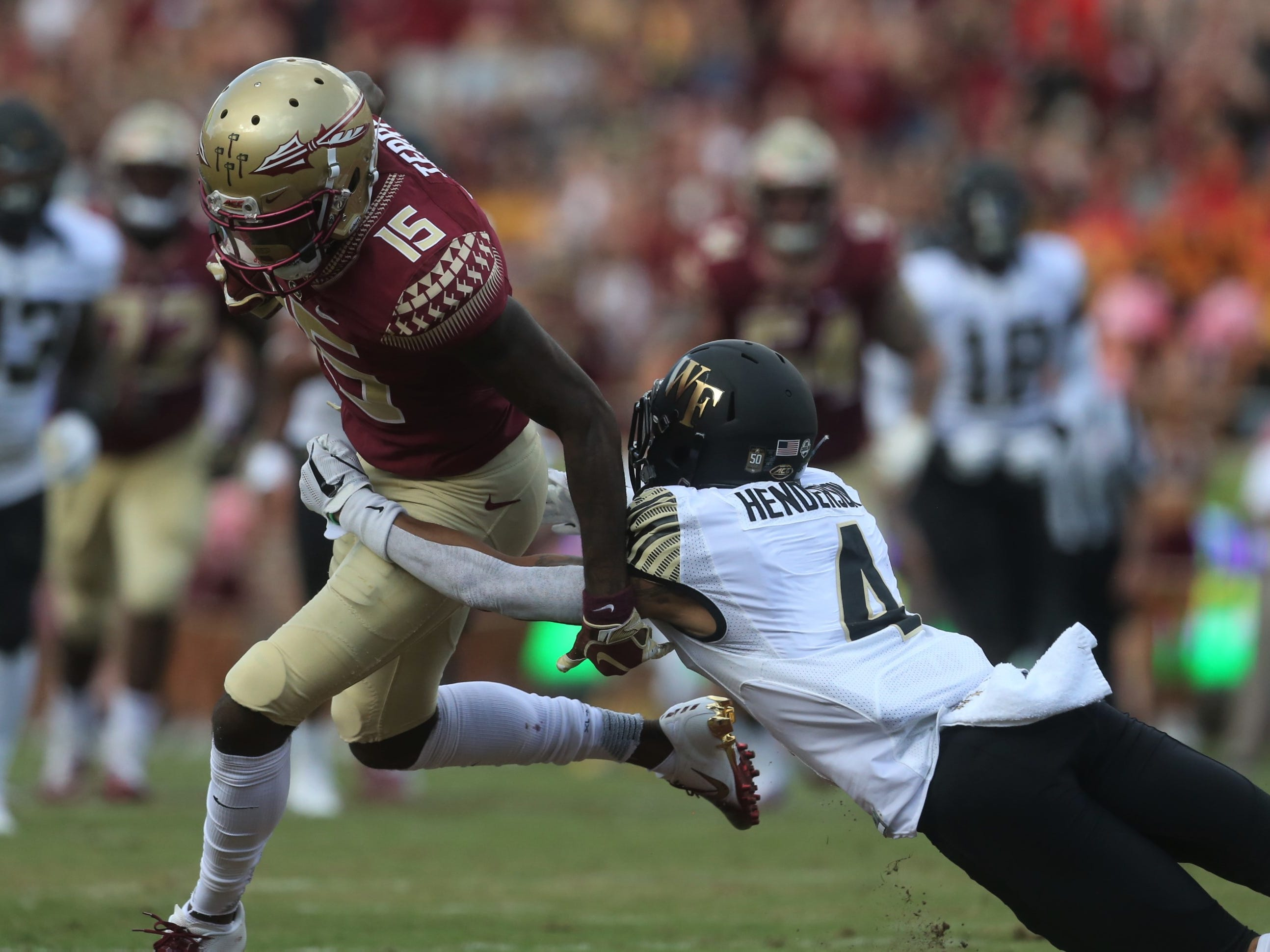 Florida State receiver Tamorrion Terry catches a pass and breaks towards the end zone as Wake Forest defensive back Amari Henderson hangs on for dear life during a game at Doak Campbell Stadium on Saturday, Oct. 20, 2018.