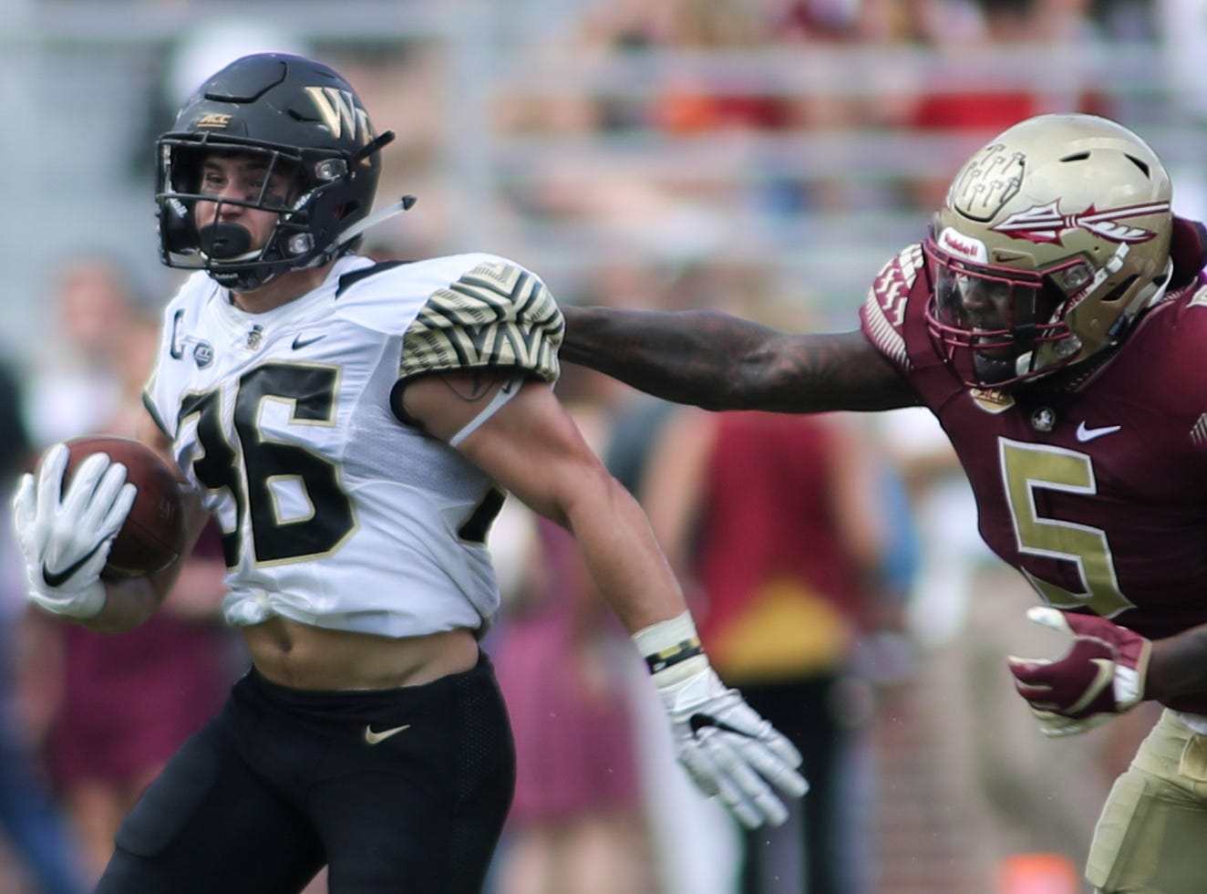 Florida State Seminoles linebacker Dontavious Jackson (5) tries to tackle Wake Forest Demon Deacons running back Cade Carney (36) during FSU's homecoming game against Wake Forest at Doak S. Campbell Stadium Saturday, Oct. 20, 2018.
