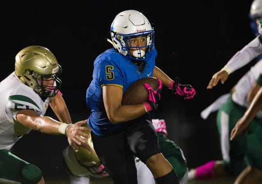 John Carroll Catholic's Savion Baker runs the ball against LaSalle in the first half of their game at John Carroll Catholic High School on Friday, October 19, 2018 in Fort Pierce. To see more photos, go to TCPalm.com.