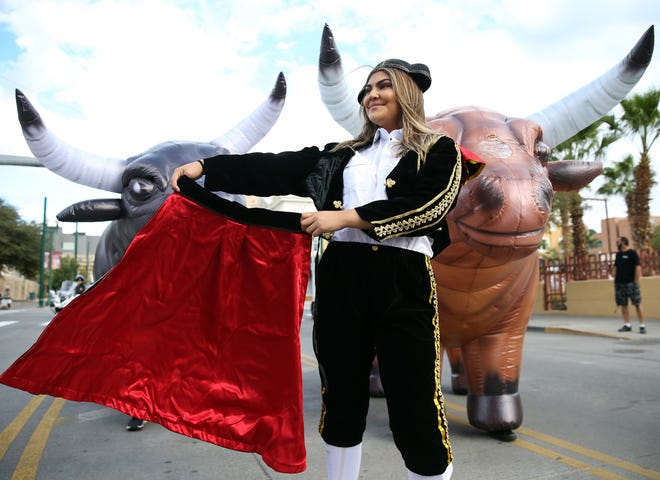 Nicole Hernandez was a matador at the second annual Running of the Bulls 5K run and walk Saturday along Oregon Street in Downtown El Paso.