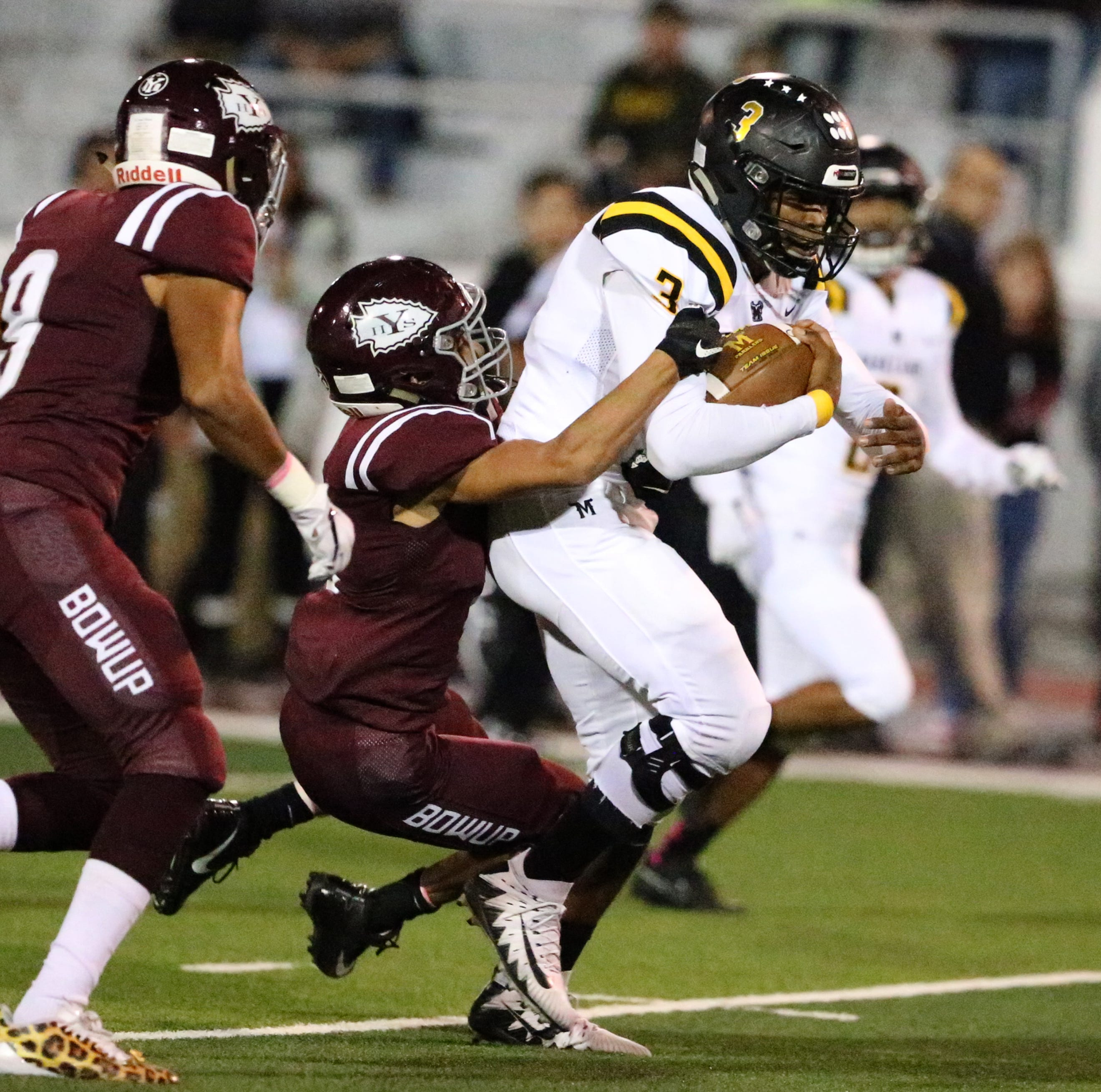 Deion Hankins of Parkland powers his way downfield against Ysleta.