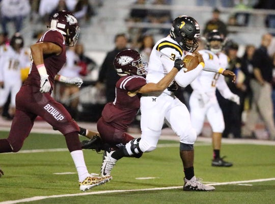 Parkland starts with 14-0 lead in the first quarter at Ysleta. Deion Hankins, 3, Powers his way downfield.