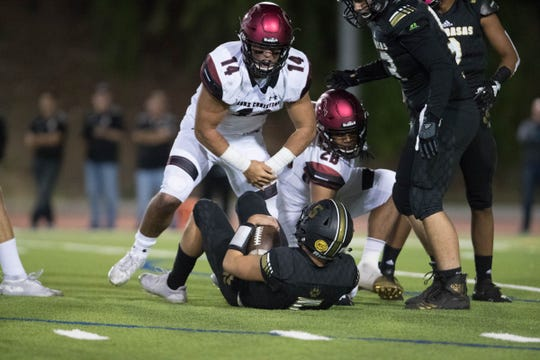 Oaks Christian's Josh Calvert celebrates after sacking Calabasas quarterback Jaden Casey during the Lions' 21-13 win Friday night.