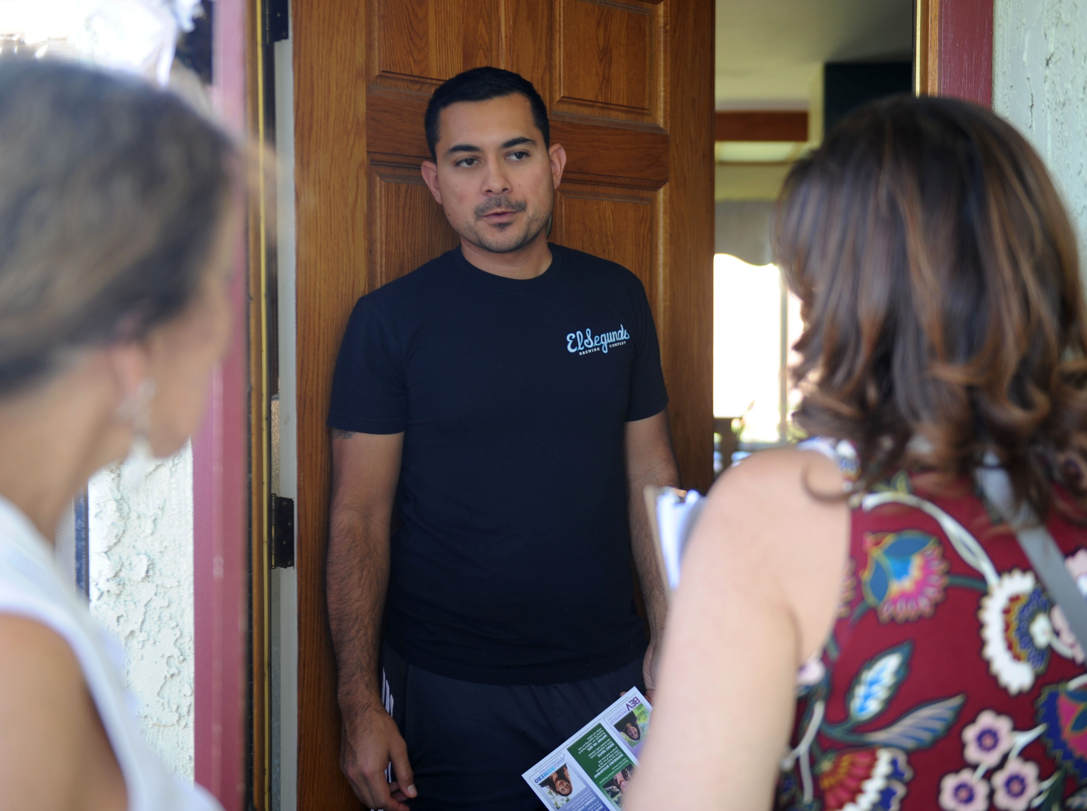 Roberto Leon, center, talks with Susan Santangelo as she goes door to door in Camarillo to talk to voters. Santangelo, Bev Dransfeldt and Jessica Romero decided to run as a ticket for Camarillo City Council. Edy Santangelo, right, joined her daughter on the campaign trail