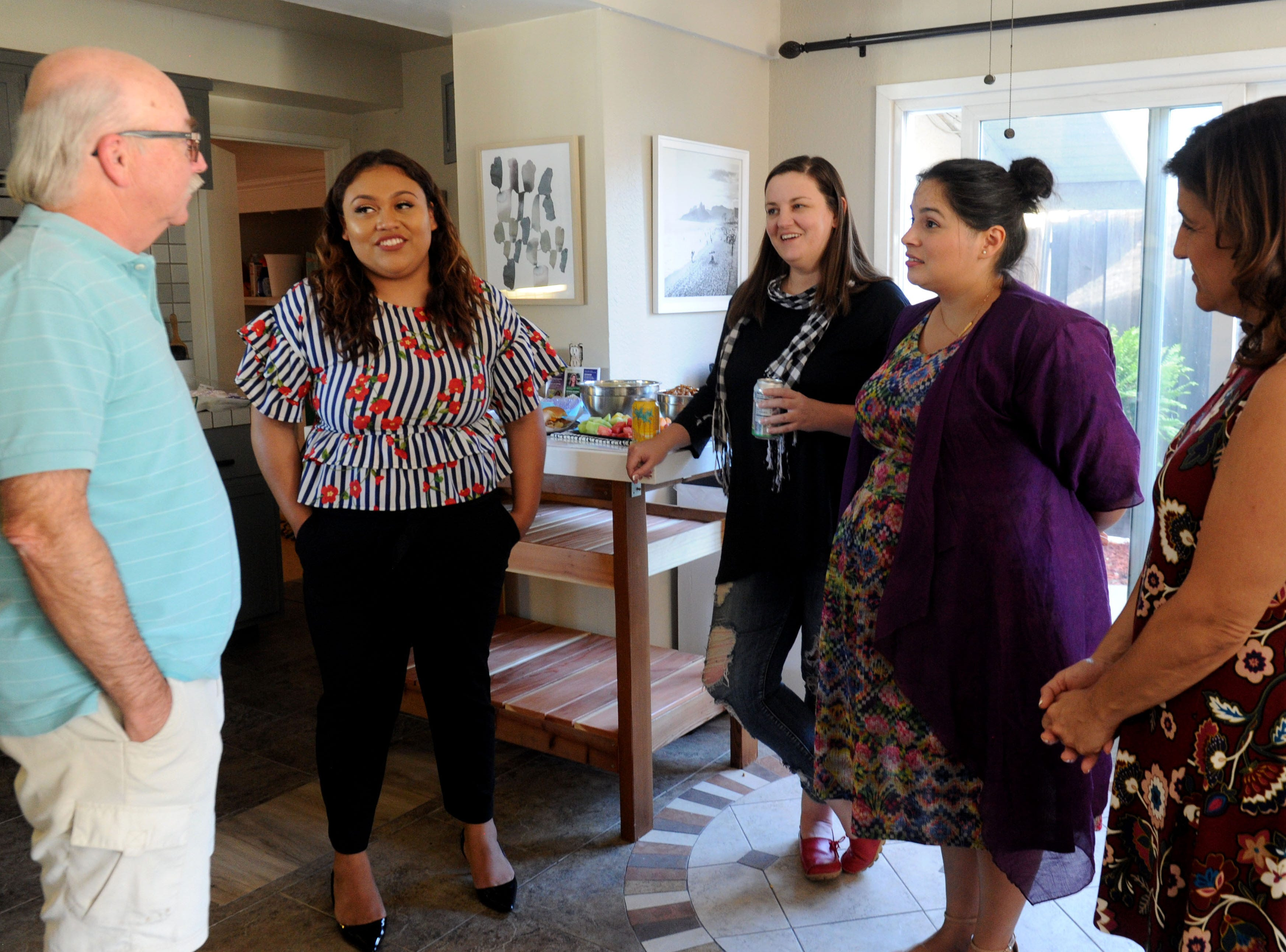 Nels Norene, left, a Camarillo resident since 1964, talks with Jessica Romero, Libby Higgins, campaign manager, Bev Dransfeldt and Susan Santangelo who are running as a ticket for Camarillo City Council.