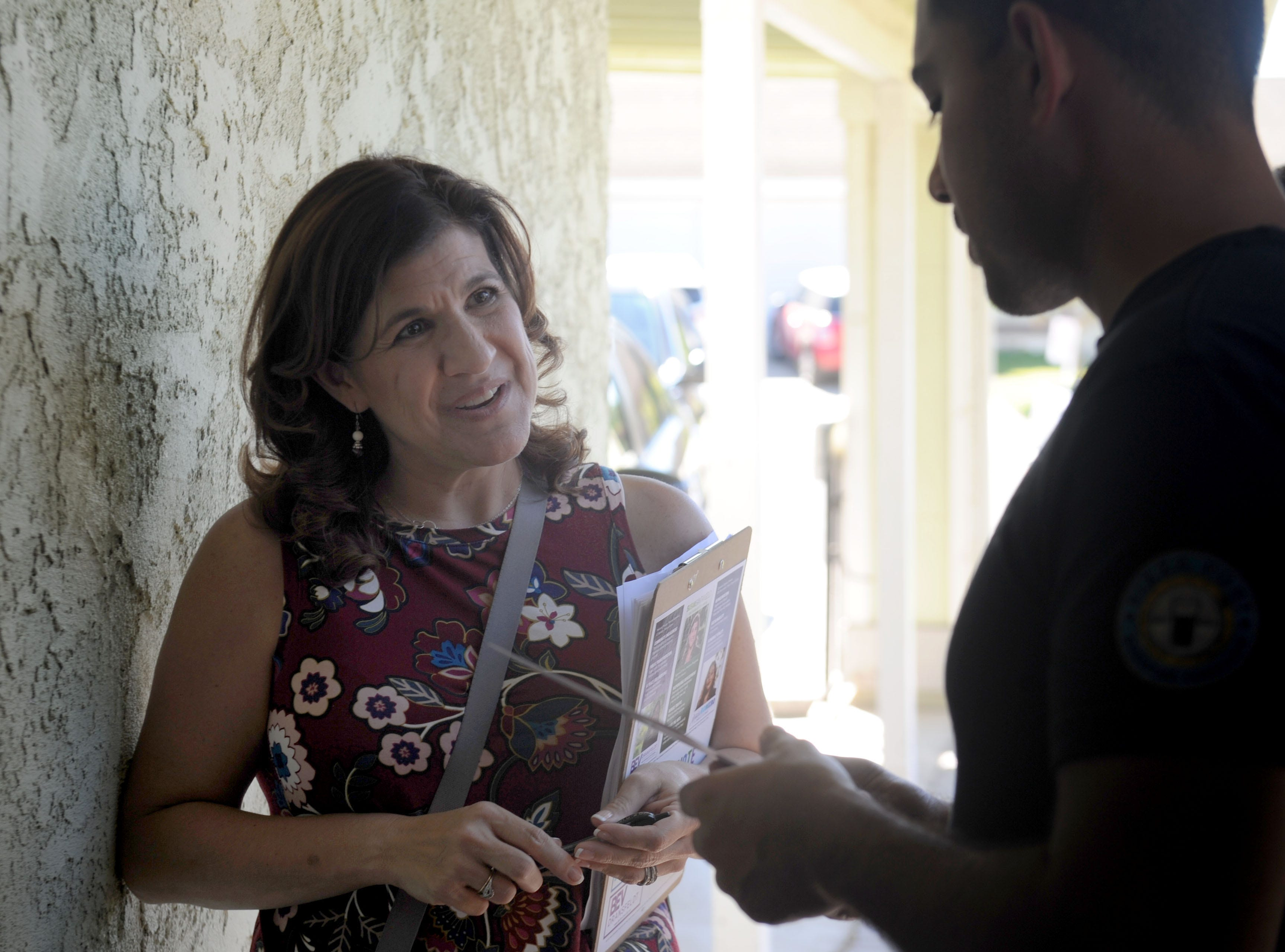 Susan Santangelo talks with Roberto Leon about Camarillo as she goes door to door to talk to voters. She, Bev Dransfeldt and Jessica Romero decided to run as a ticket for Camarillo City Council.