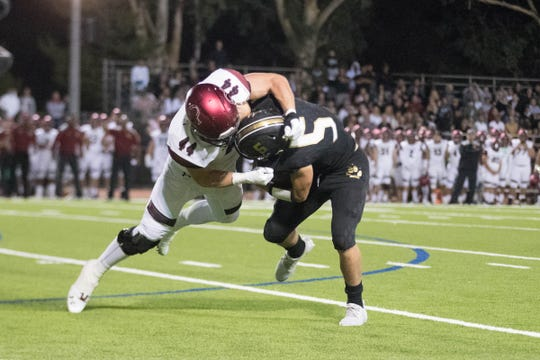 Jack Lenthall sacks Calabasas quarterback Jaden Casey during Oaks Christian's win earlier this month.