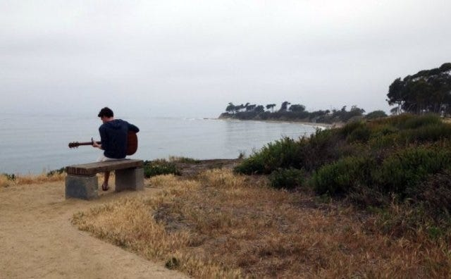 STAR FILE PHOTO A guitarist plays on bluffs overlooking the ocean in Isla Vista.