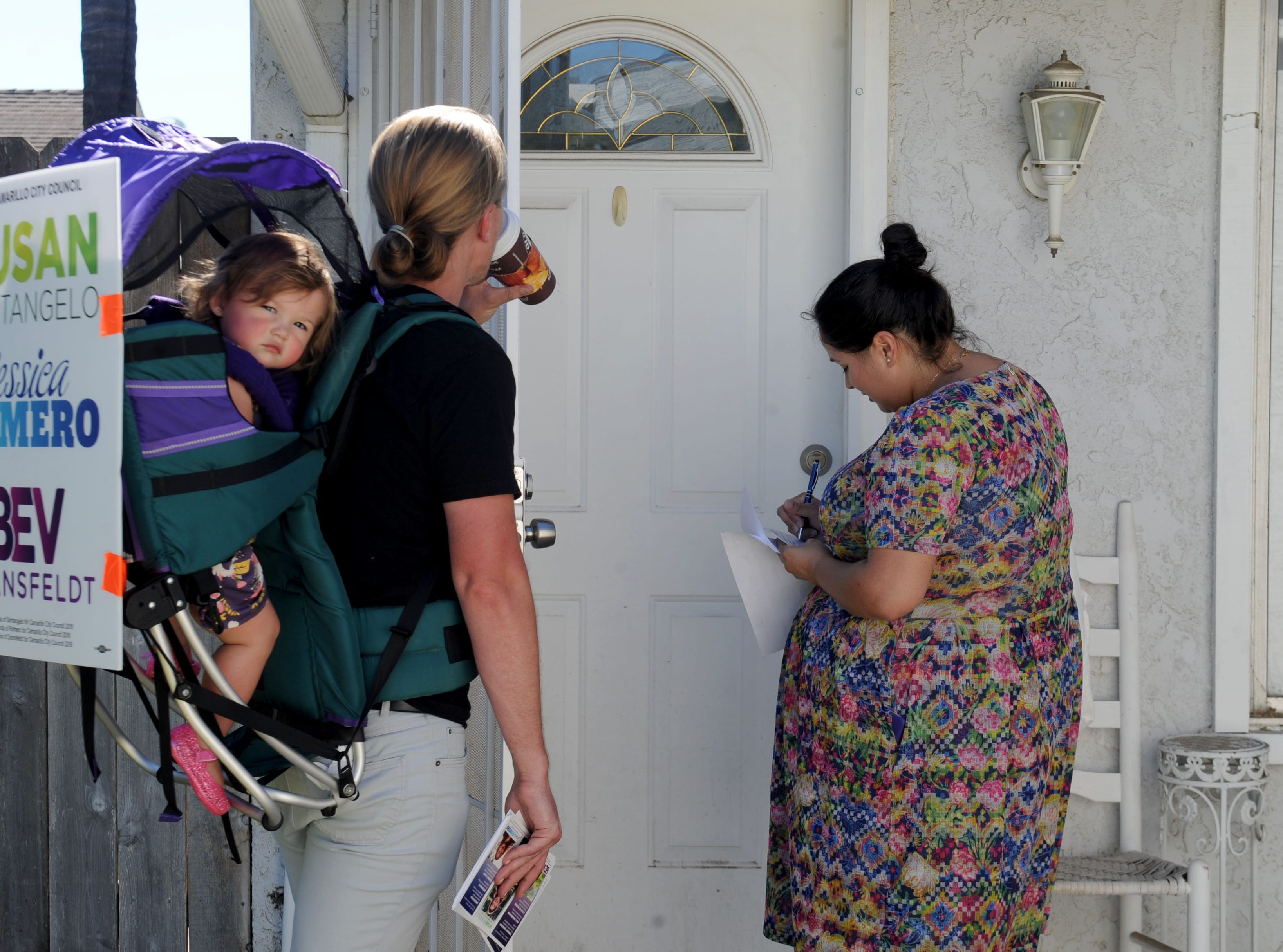 Bev Dransfeldt, right, goes door to door in Camarillo with her husband, Cory Dransfeldt, and daughter Pazita. Bev Dransfeldt, Susan Santangelo and Jessica Romero decided to run as a ticket for Camarillo City Council.