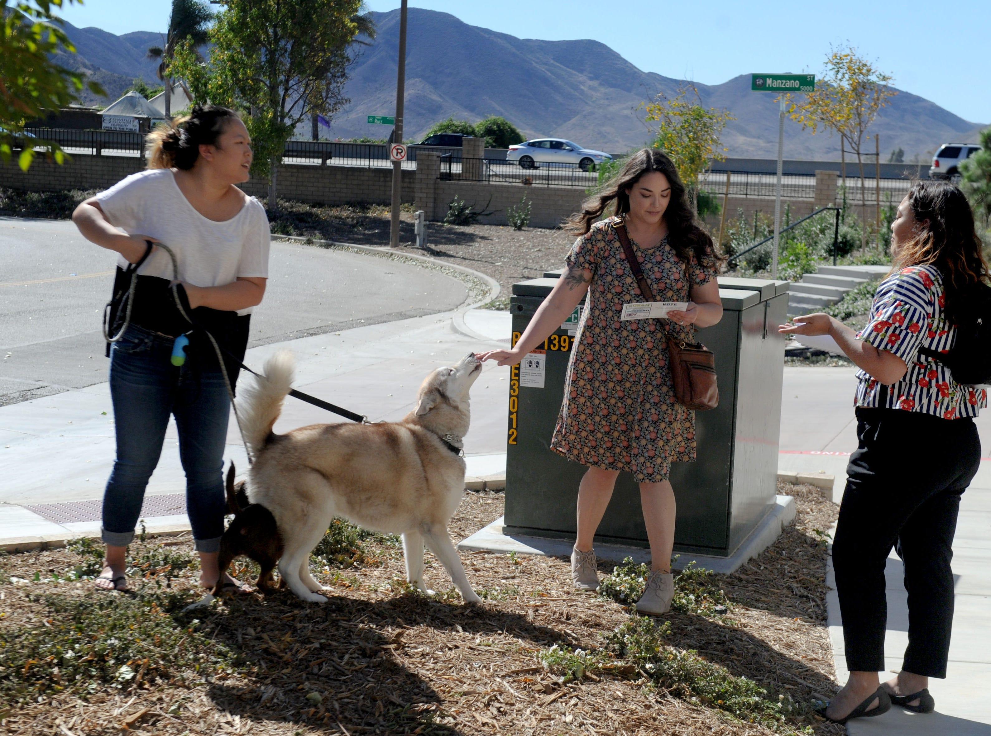Linda Chun, left, and Stephanie Isomura talk with Jessica Romero in Camarillo.  Romero, Bev Dransfeldt and Susan Santangelo decided to run as a ticket for Camarillo City Council.