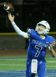 Fillmore quarterback Jake Saviers fires a pass during the Flashes' 31-24 upset of rival Santa Paula on Friday night.