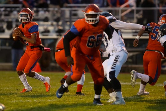 Millville's Eddie Jamison Jr looks to pass the ball against Atlantic City at Millville High School, October 19, 2018.