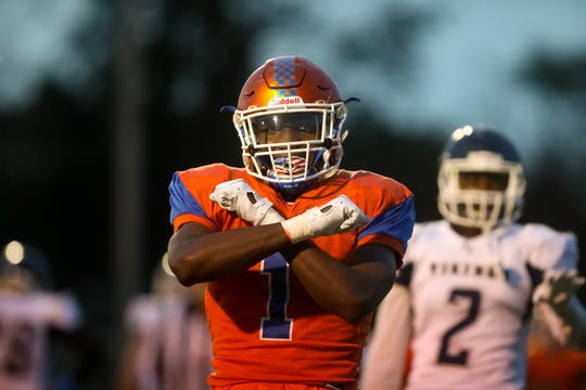 Millville's Soloman Deshields reacts after scoring a touchdown against against Atlantic City at Millville High School.