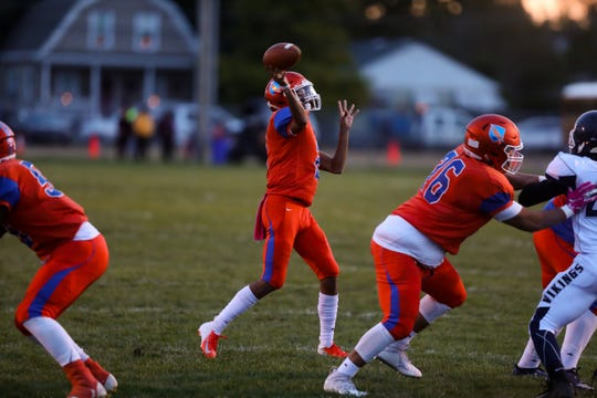 Millville's Eddie Jamison Jr.looks to throw the ball against Atlantic City Friday. October 19, 2018, at Millville High School.