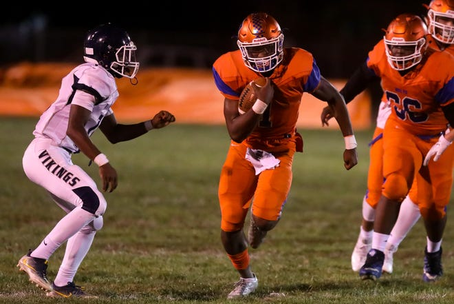 Millville's Soloman Deshields runs for a long gain against Atlantic City at Millville High School.