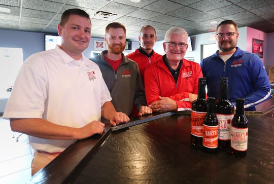 Paul Ver Voort, Mark Ver Voort, Seth Ponschock, Gary Ver Voort, and Jim Ver Voort stand next to a few bottles of Gary's Old Fashioned Mix at Buzz's Pub & Grill Thursday, Oct. 4, 2018, in Freedom, Wis. Danny Damiani/USA TODAY NETWORK-Wisconsin