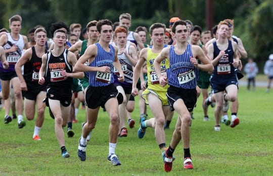 Bronxville's Matt Rizzo is at the head of the pack during the start of the second boys varsity race during the Section 1 Coaches Cross-Country Invitational at Bowdoin Park in Wappingers Falls on Oct. 20. Rizzo won the race. His twin brother, Alex, is left of him.