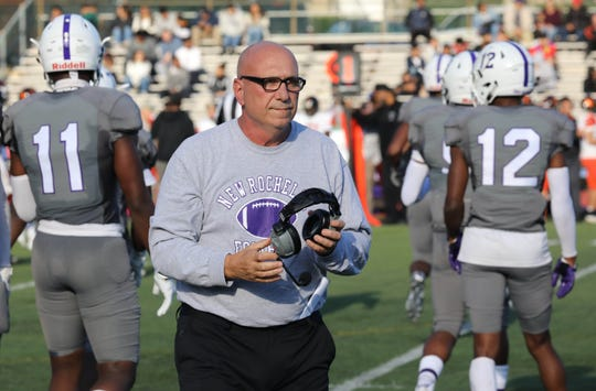 New Rochelle head coach Lou DiRienzo walks off the field during the Class AA quarterfinal playoff game against White Plains at New Rochelle High School, Oct. 20, 2018.