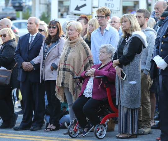 Michael Paige, left, and his family attend the 37th the annual Brinks memorial ceremony in Nyack on Saturday, October 20, 2018.