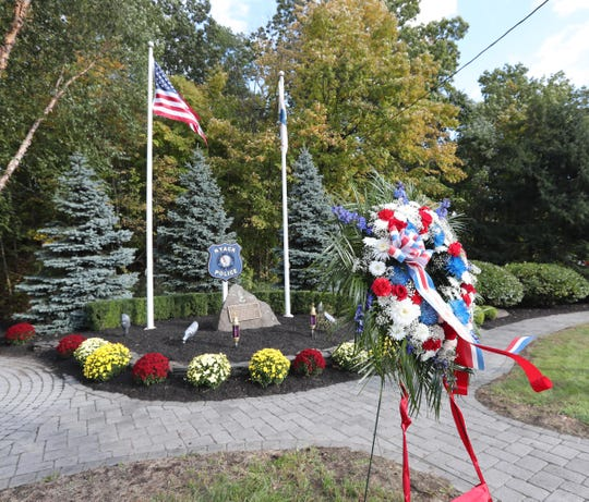 Wreaths placed near the memorial during the 37th annual Brinks memorial ceremony in Nyack on Saturday, October 20, 2018.