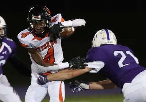 Spring Valley's Tyesheek Ruffin tries to break away from John Jay's Ryan Brennan (21) during playoff football action at John Jay High School in Cross River Oct. 19, 2018.
