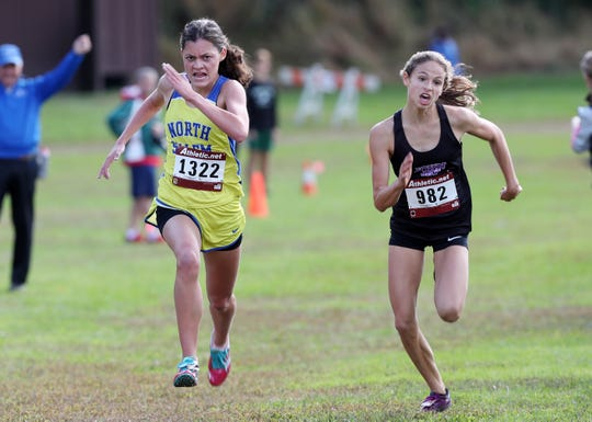 John Jay-Cross River's Kelsey Crawford (r) and North Salem's Ava Jolley (l) battle to the finish of the  first girls varsity race during the Section 1 Coaches Cross-Country Invitational at Bowdoin Park in Wappingers Falls Oct. 20, 2018.