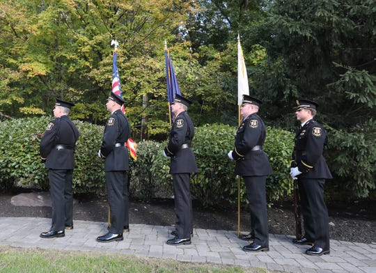 Clarkstown Police Honor Guard present the flags during the annual Brinks memorial ceremony in Nyack on Saturday, October 20, 2018.