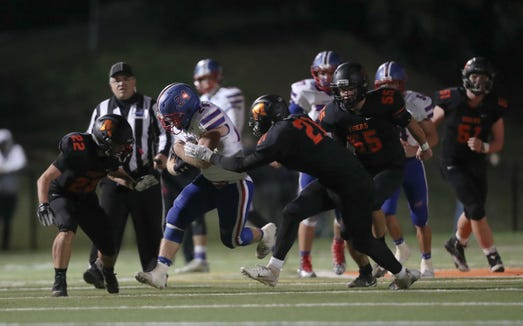 Carmel running back Sam Duke (24) with the carry during their 27-20 win over Mamaroneck in the Class AA football quarterfinal playoff game at Mamaroneck High School on Friday, October 19, 2018.