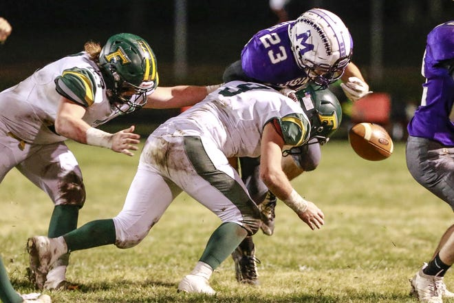 Mosinee's William Kennedy , right, fumbles the ball after a hit from Freedom's Noah Schadrie Friday during the first half of a WIAA Division 3 opening-round football playoff game. Mosinee recovered the ball on the play.
