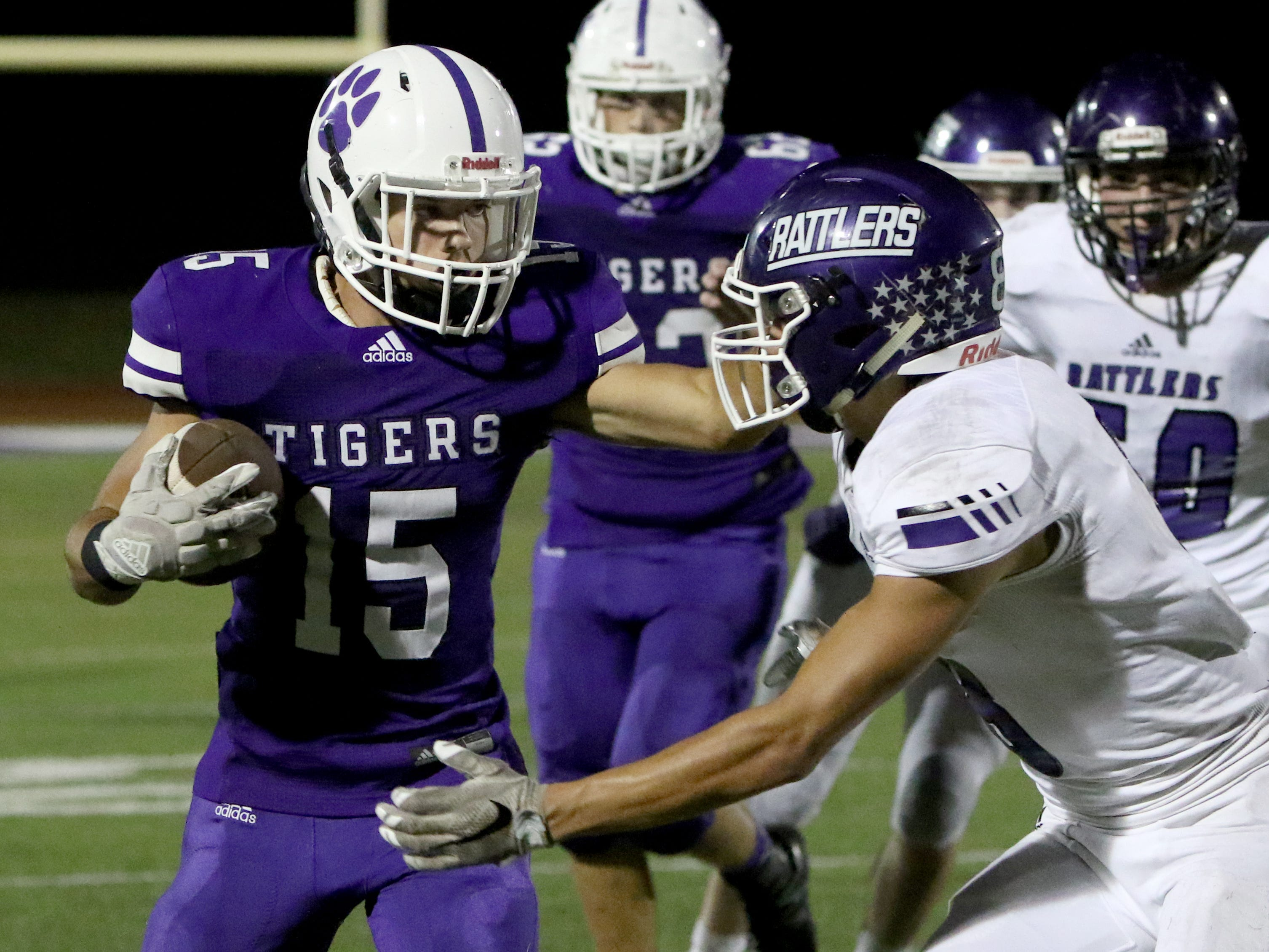 Jacksboro's Ethan Fudge is pushed out of bounds by Tolar's Mason Behrens Friday, Oct. 19, 2018, in Jacksboro. The Tigers defeated the Rattlers 42-21.