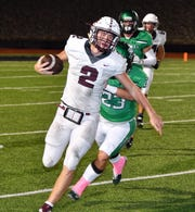 Vernon quarterback BT White (2) gets run out of bounds by Iowa Park's Zane Petering (23) in first half action Friday night in Iowa Park. The Hawks led the Lions, 13-6, at halftime.